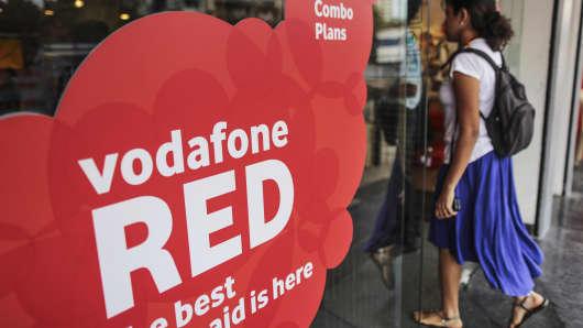 A customer enters a Vodafone store in Mumbai, India.