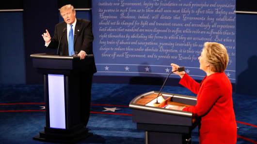 Republican presidential nominee Donald Trump and Democratic presidential nominee Hillary Clinton speak during the Presidential Debate at Hofstra University on September 26, 2016 in Hempstead, New York.