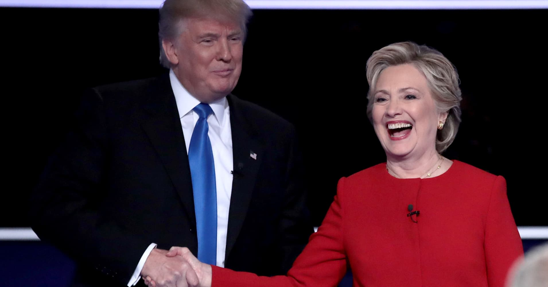 Republican presidential nominee Donald Trump and Democratic presidential nominee Hillary Clinton shake hands after the Presidential Debate at Hofstra University on September 26, 2016 in Hempstead, New York.