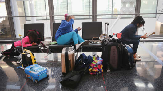Passengers wait for flights at O'Hare International Airport.