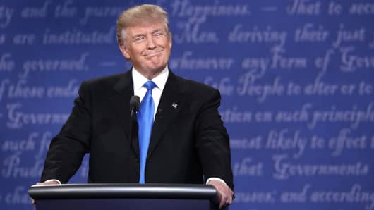 Republican presidential nominee Donald Trump smiles during the Presidential Debate at Hofstra University on September 26, 2016 in Hempstead, New York.