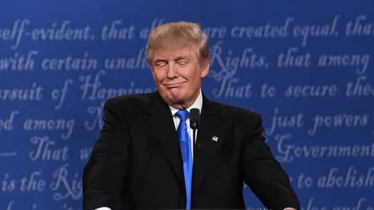 Republican nominee Donald Trump smiles during the first presidential debate at Hofstra University in Hempstead, New York on September 26, 2016.