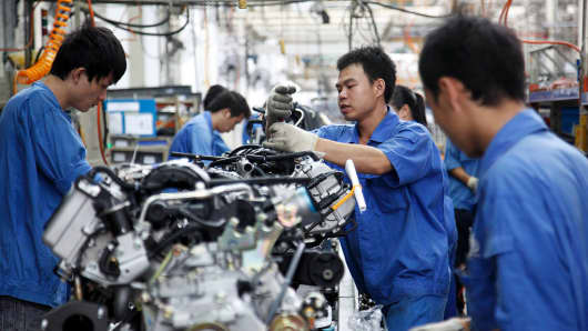 Workers operate on the assembly line at an automobile factory in Liuzhou, Guangxi Province, China.