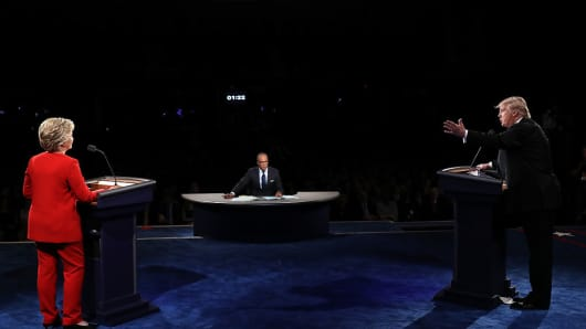 Republican presidential nominee Donald Trump (R) speaks as Democratic presidential nominee Hillary Clinton (L) listens during the Presidential Debate at Hofstra University on September 26, 2016 in Hempstead, New York.