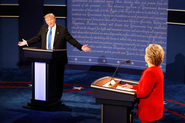 Republican presidential nominee Donald Trump (L) speaks as Democratic presidential nominee Hillary Clinton listens during the Presidential Debate at Hofstra University on September 26, 2016 in Hempstead, New York.
