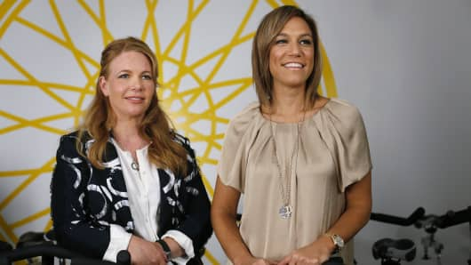 Elizabeth Cutler, left, and Julie Rice, right, co-founders of SoulCycle LLC, stand for a photo at a Soul Cycle studio