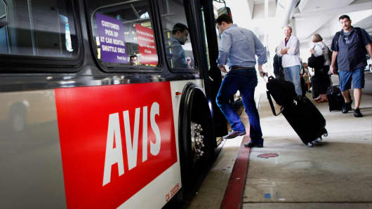 A passenger boards an Avis shuttle bus at Los Angeles International Airport.