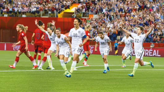 Carli Lloyd (10) celebrates after beating Germany in the World Cup semifinals. Her penalty kick got the US on the board – and on the way to a 2-0 victory.