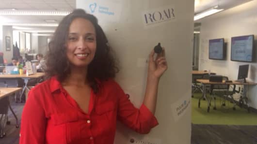 Yasmine Mustafa, founder of ROAR for Good, has designed a wearable device akin to a Fitbit to help keep women safe.
