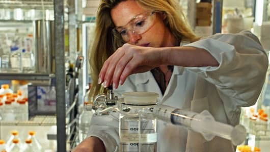 A research associate performs a buffer exchange for protein formulation at AMGEN, a drug research and development laboratory.