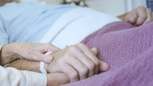 In a hospital bed, Life insurance warnin