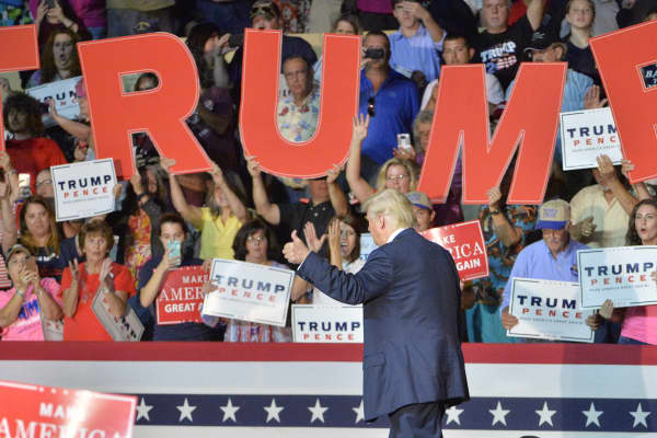 Republican presidential nominee Donald Trump acknowledges supporters' cheers during a campaign event at the Berglund Center on September 24, 2016 in Roanoke, Virginia.