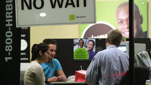 An H&R Block tax preparer assists customers in Des Plaines, Illinois