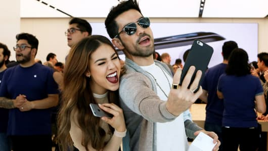 Customers take a selfie as they enter the first Apple Store in Mexico City, Mexico, on September 24, 2016.
