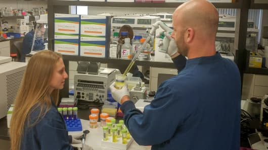 Scientists processing urine samples in the Cambridge, Mass., lab of Exosome Diagnostics.