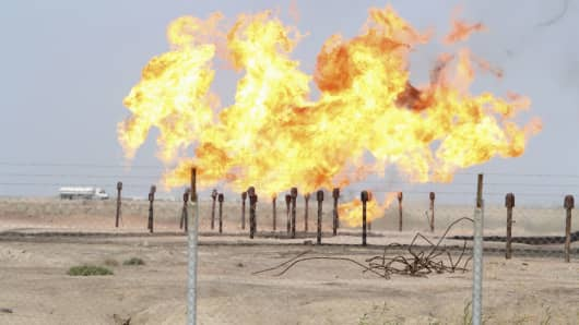 Excess gas is burnt off at a pipeline at Rumaila oilfield in Basra, Iraq.