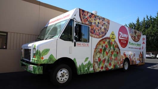 Zume developed its own special delivery truck with 56 ovens so the pizza can cook while en route to customers.