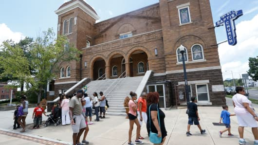 Visitors walk in front of the Sixteenth Street Baptist Church in Birmingham, Alabama.