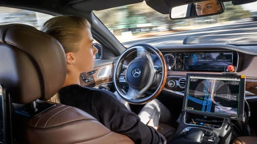 A hands-free driver in a Mercedes-Benz.
