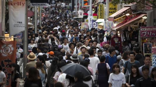 Shoppers walk through the Takeshita Street in Tokyo, Japan.
