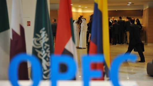 Participants gather in the lobby ahead of an informal meeting between members of the Organization of Petroleum Exporting Countries, OPEC, in the Algerian capital Algiers, on September 28, 2016.