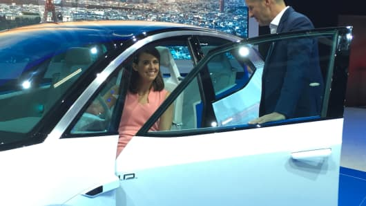 Nancy Hungerford sits inside the Volkswagen I.D., a dedicated electric car