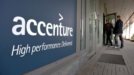 People enter an Accenture office in downtown Helsinki, Finland.