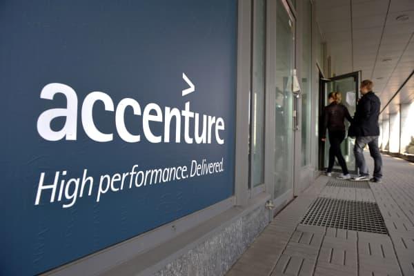 People enter an Accenture office in downtown Helsinki, Finland.