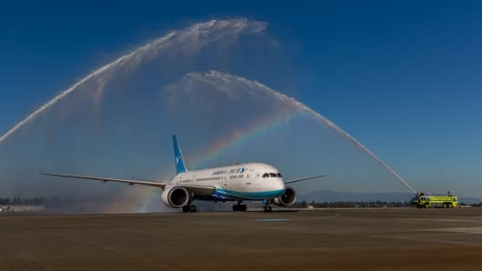 Xiamen Airlines' first flight to the United States is welcomed at Seattle-Tacoma International Airport with a traditional water cannon salute.