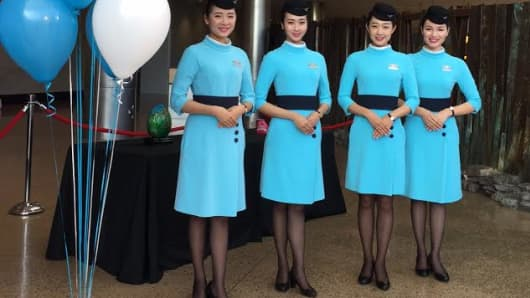 Xiamen Airlines cabin crew ready wait for the ceremony welcoming Xiamen Airlines to Seattle-Tacoma International Airport to begin.