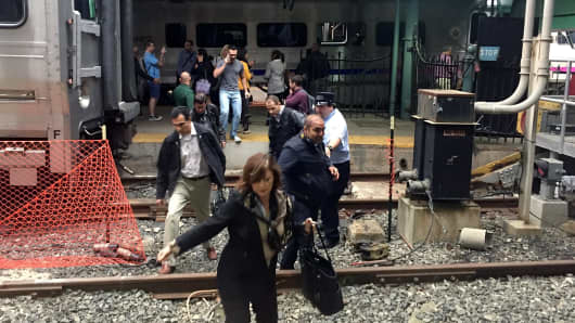Passengers rush to safety after a NJ Transit train crashed in to the platform at the Hoboken Terminal September 29, 2016 in Hoboken, New Jersey.New Jersey emergency's management system is reporting more than 100 people were injured in the crash.