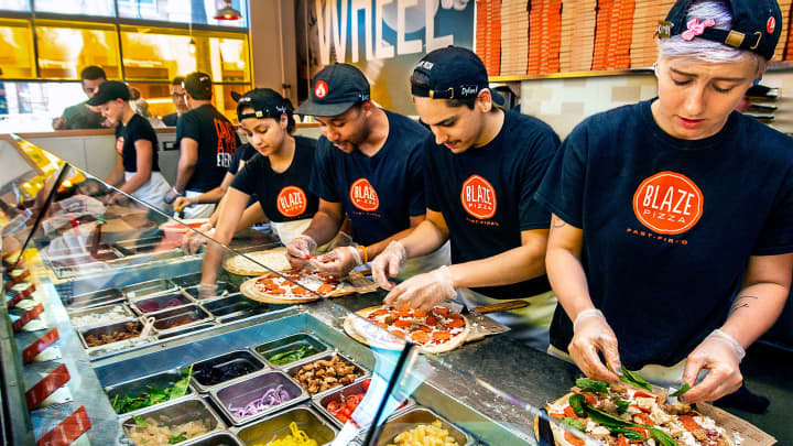 Assembly line at Blaze Pizza