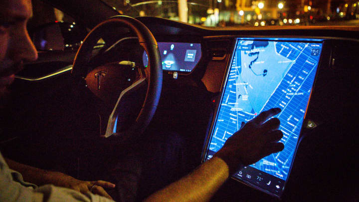 A driver uses the map navigation feature on a touchscreen control panel with the Tesla Motors Inc. 8.0 software update inside a Tesla Model S P90D vehicle.