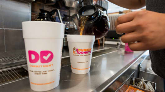 An employee fills a coffee order at a Dunkin' Donuts location in Ramsey, NJ.