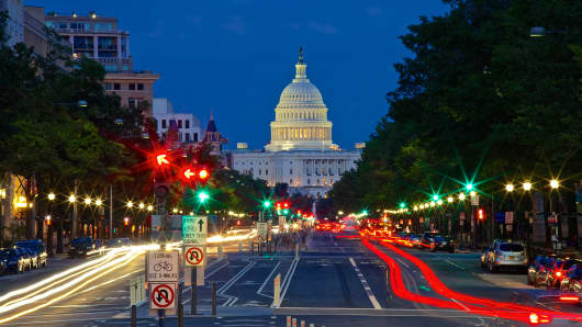 The United States Capitol Building as viewed with traffic from Pennsylvania Avenue.
