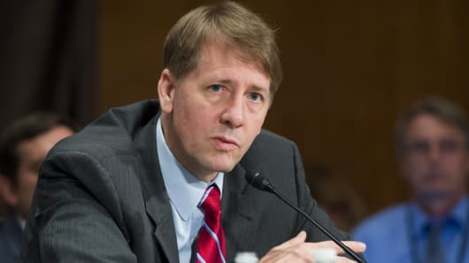 Director Richard Cordray of the Consumer Financial Protection Bureau testifies about the unauthorized opening of accounts by Wells Fargo during a Senate Banking, Housing and Urban Affairs Committee hearing on Capitol Hill in Washington, DC, September 20, 2016.