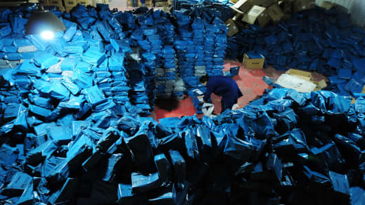 Workers sort out packages in Jiujiang City in Jiangxi Province ahead of Singles' Day.