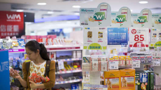 A woman browses products in a Watsons store in the Tsim Sha Tsui district of Hong Kong.