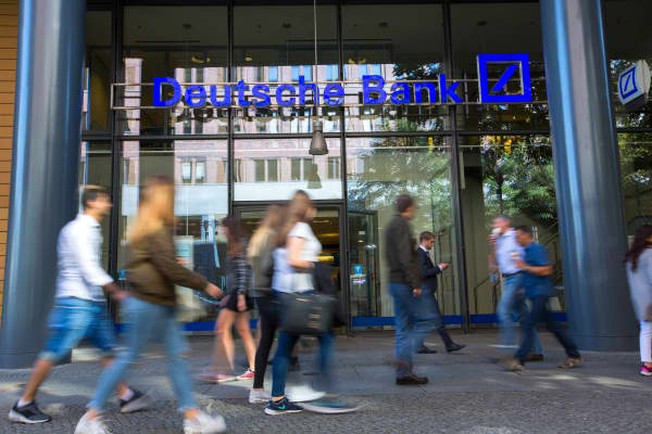 Pedestrians walks past a Deutsche Bank AG bank branch in Berlin, Germany, on Tuesday, Sept. 27, 2016.