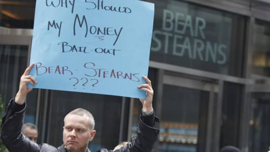 A demonstrator holds a sign outside Bear Stearns headquarters in New York, on Wednesday, March 26, 2008.