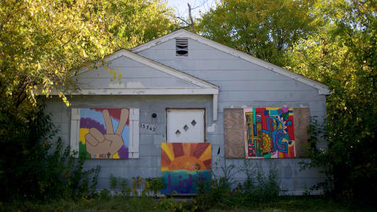 Art is placed on the front of the majority of the abandoned houses in the neighborhood of Brightmoor seen in Detroit