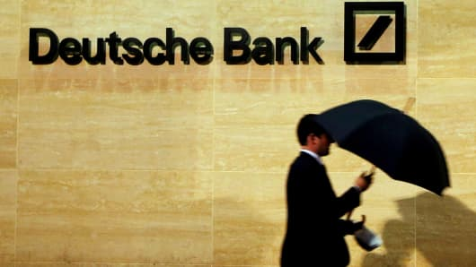 A man walks past Deutsche Bank offices.