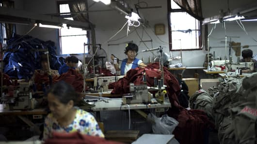 Workers prepare to sew t-shirts in a factory in Zhujiajiao, on the outskirts of Shanghai.