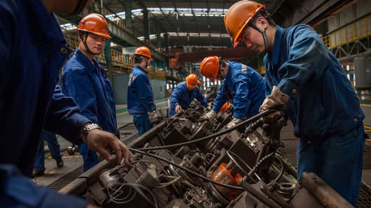 Workers at the Zhong Tian (Zenith) Steel Group factory in Changzhou, Jiangsu.