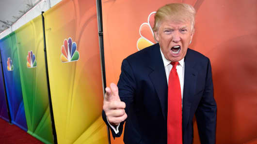 "In this Jan. 16, 2015 file photo, Donald Trump, host of the reality television series ""The Celebrity Apprentice,"" poses for photographers at the NBC 2015 Winter TCA Press Tour in Pasadena, Calif."