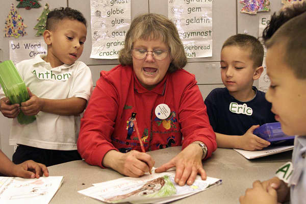 A substitute teacher at Hueneme School in Port Hueneme, gives a lesson to kindergarteners on Friday afternoon.