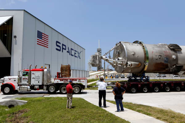 The recovered first stage of a SpaceX Falcon 9 rocket is transported to the SpaceX hangar at launch pad 39A at the Kennedy Space Center in Cape Canaveral, Florida May 14, 2016.