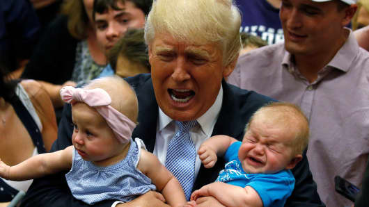 Republican presidential nominee Donald Trump holds babies at a campaign rally in Colorado Springs, Colorado, U.S., July 29, 2016.