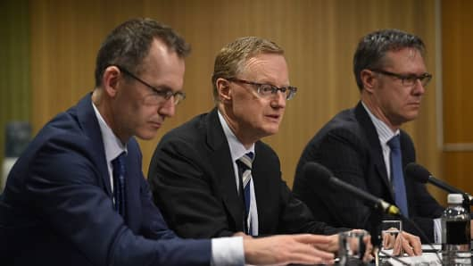 New Reserve Bank of Australia Governor Philip Lowe (C) speaks at a parliamentary economics committee hearing flanked by new Deputy Governor Guy Debelle (R) and the Assistant Governor Christopher Kent (L) in Sydney on September 22, 2016.
