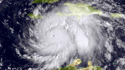 This NOAA handout image, taken by the GOES satellite at 1620 UTC, shows Hurricane Matthew in the Caribbean Sea heading toward Jamacia, Haiti and Cuba on October 3, 2016.